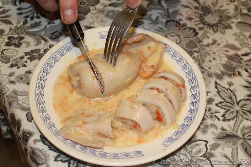 Кальмары, фаршированные рисом и рыбой